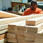 Assembling lumber to manufacture trusses